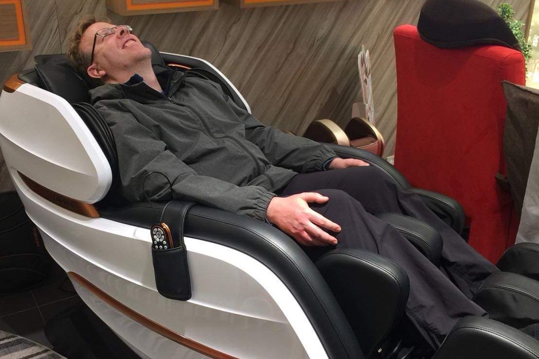 trying out massage chair